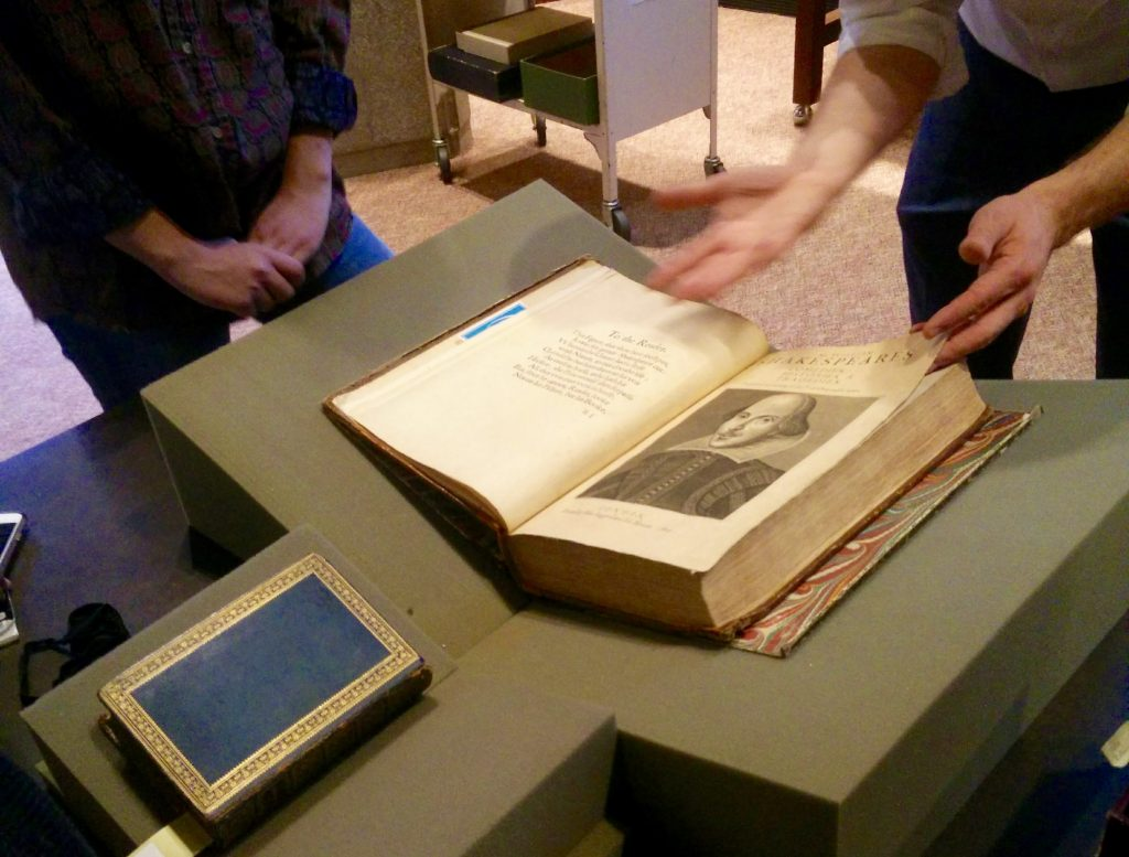 Shakespeare's First Folio open to the title page with his portrait drawing.