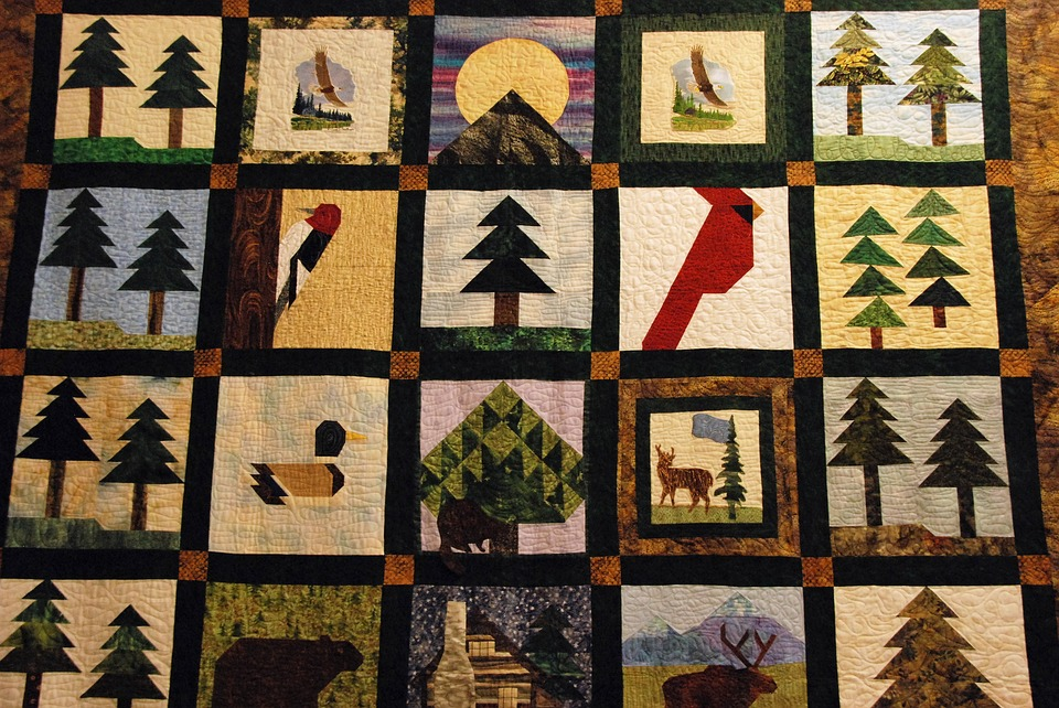 A quilt with various nature patterns