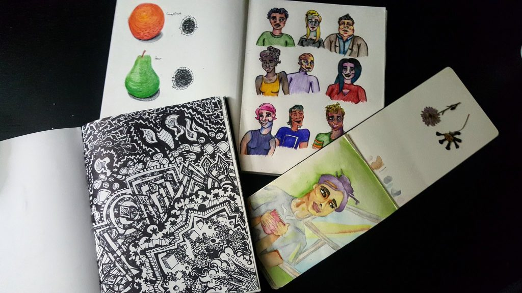 a collection of open sketchbooks displaying doodles of people's faces