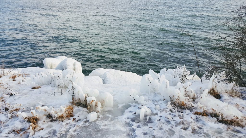 an icey beach overlooking lake ontario