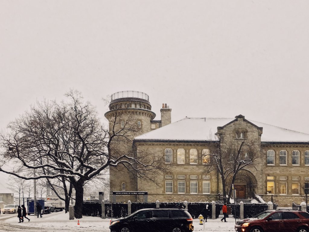 A photo of the Munk School on a snowy day.
