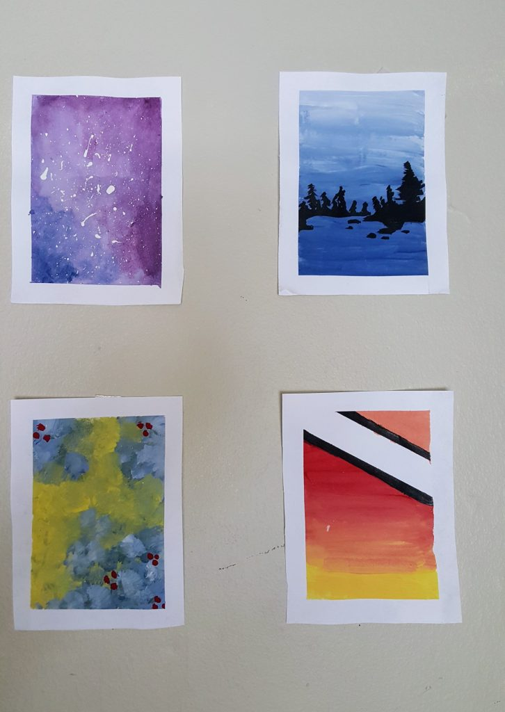 the four completed panels, hung up on a beige wall beside each other