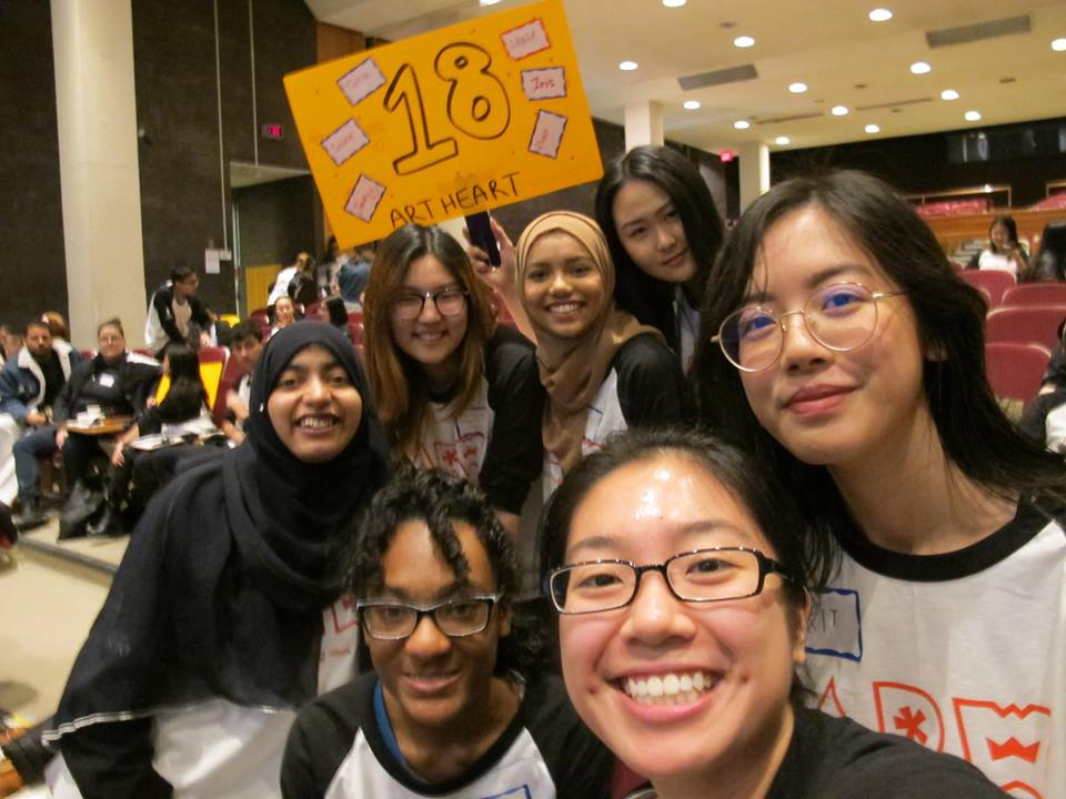 Our first group selfie with the project 18 sign and everything