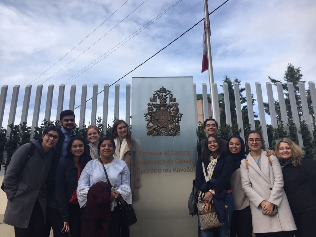 A picture of the ICM student outside the Canadian embassy in Athens, Greece.