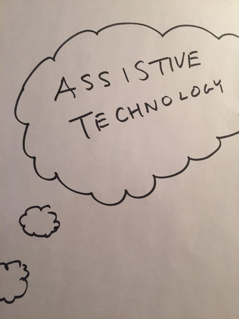 "White paper with bubble drawn on that says ""Assistive Technology"" in black marker"