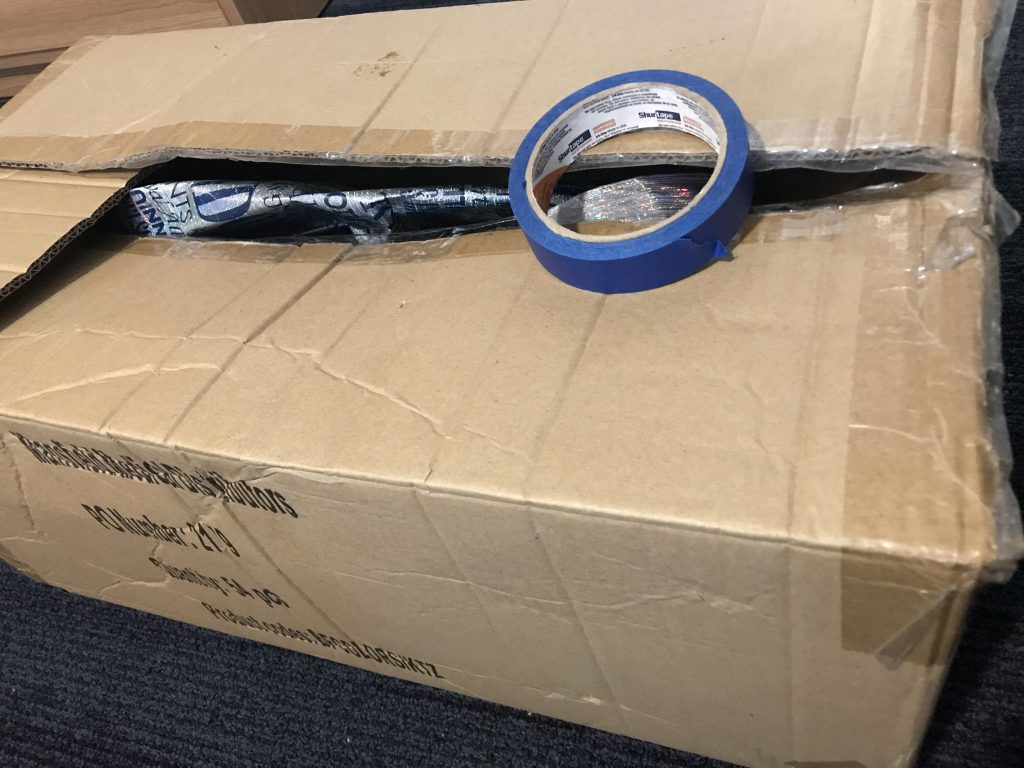 A photo of a box and tape