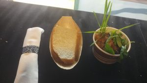 Photo of hunters stew with bread and cutlery