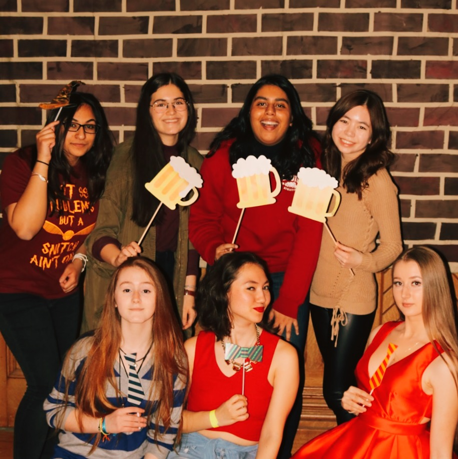 A group photo of girls at Harry Potter Pub Night.