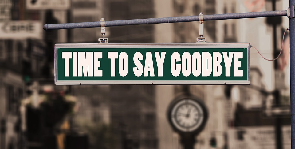 A sign with 'time to say goodbye' on it