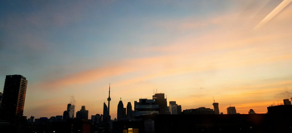 The city of toronto skyline at sunset