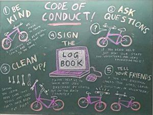 blackboard with bikechain code of conduct