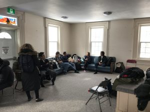 students and alumni getting settled in inside the farm house