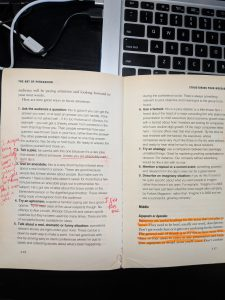 An image of a book with highlighted and underlined passages as well as notes in the margins.