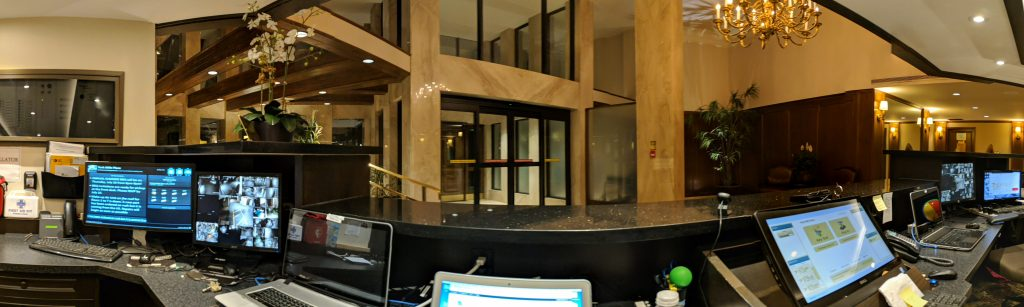 An image of an empty condo building lobby from the perspective of a security desk.