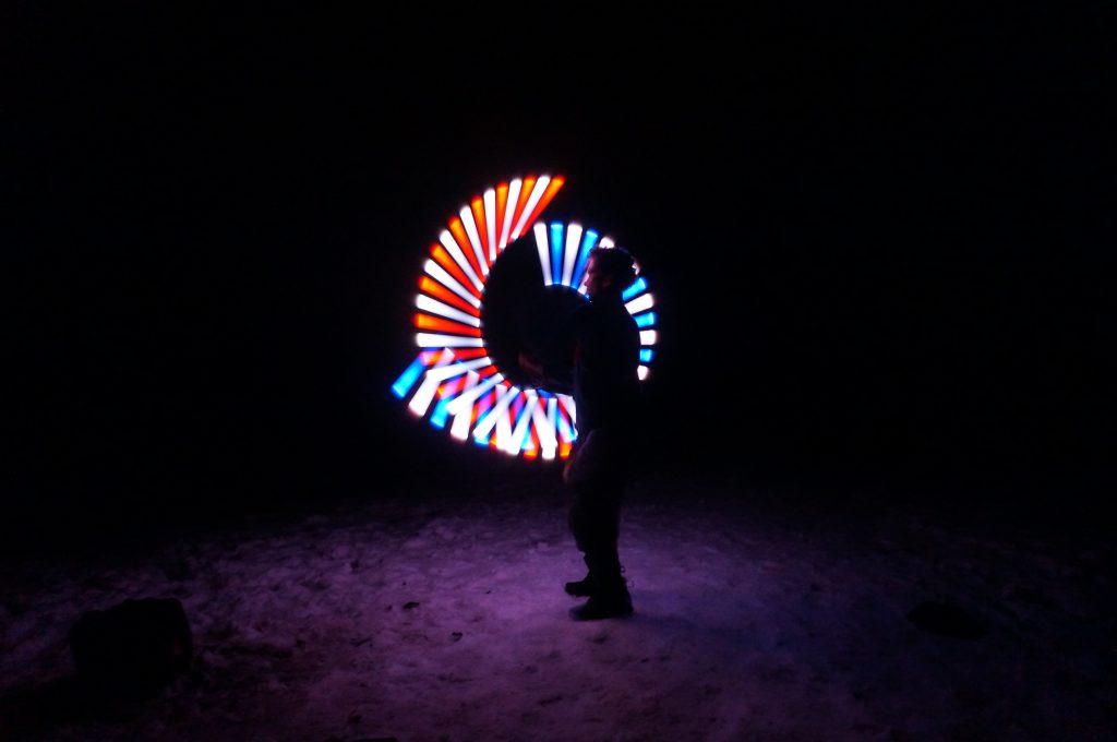 Boy making patterns using a light staff