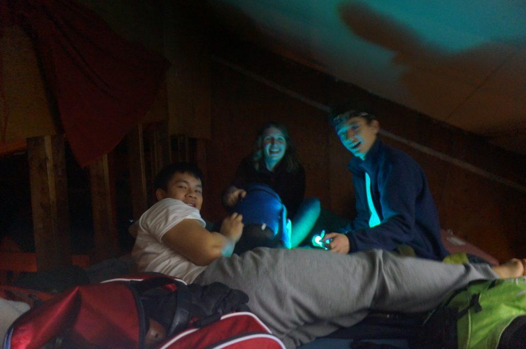 3 students in sleeping bags