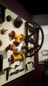wall of gears and other parts of machinery