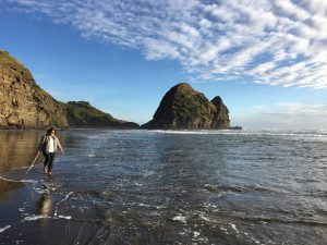 A photo of me at Piha Beach in New Zealand