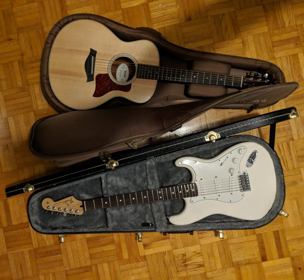 An image of a white electric guitar and a spruce top acoustic guitar