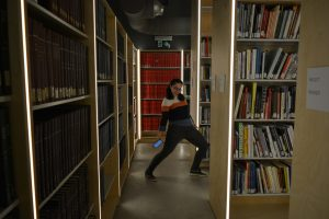 girl striking a pose in library