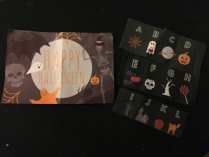 Happy Halloween card with a bat, skeleton, ghost, pumpkin and spider