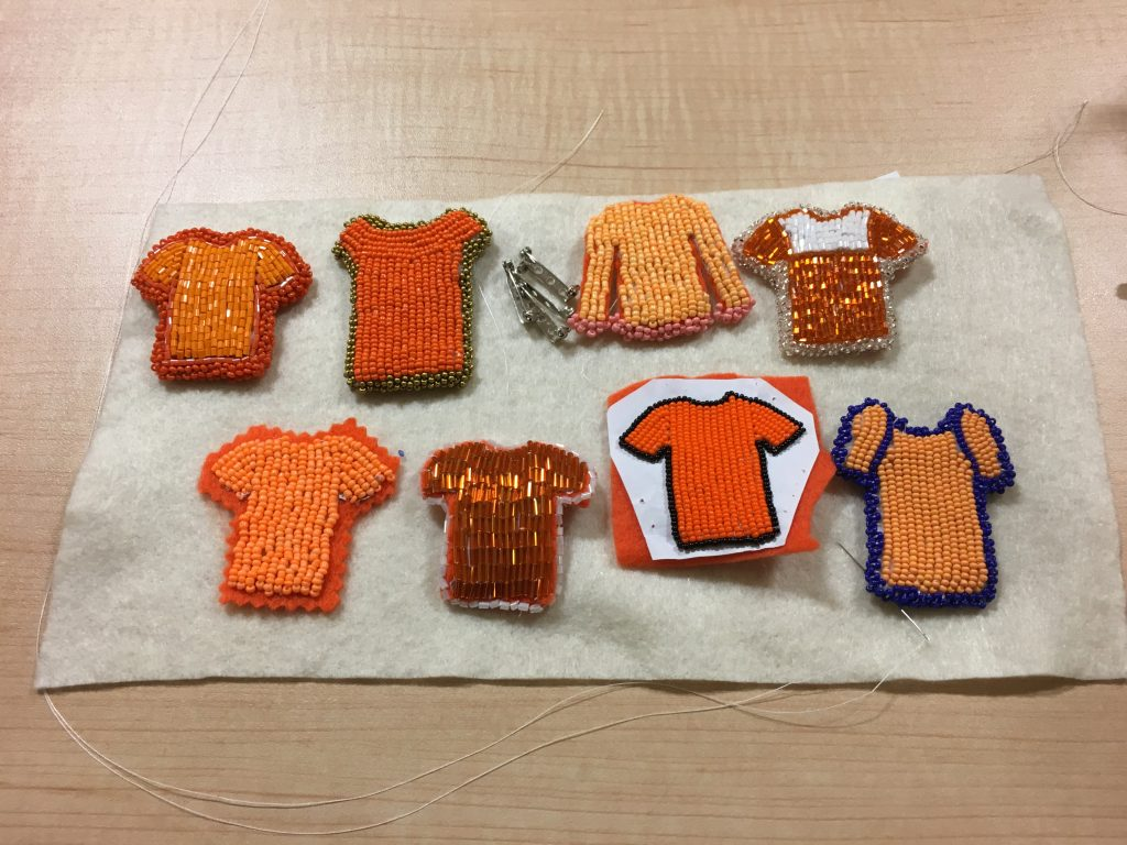 Jenny Blackbird's collection of orange shirt beadings