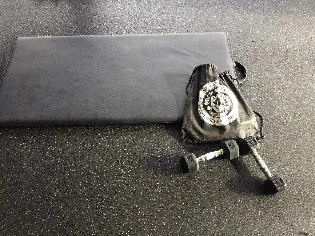 Workout mat, dumbbells, and gym bag