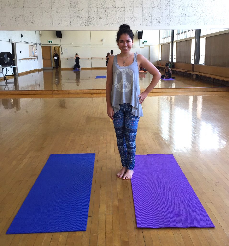 Author standing on a yoga mat in the dance studio