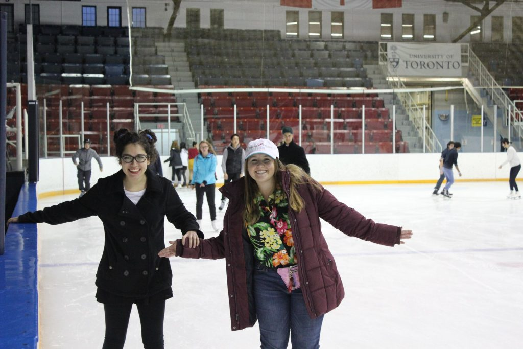 Me holding onto my friend on the ice rink