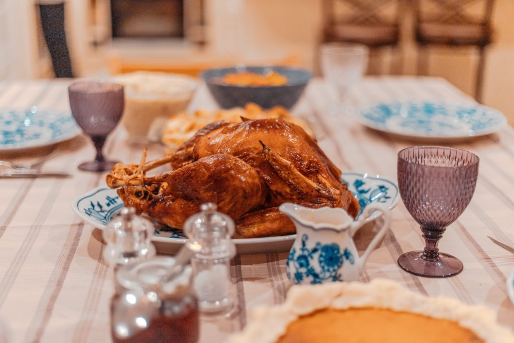 Turkey on a dinner table with table settings.