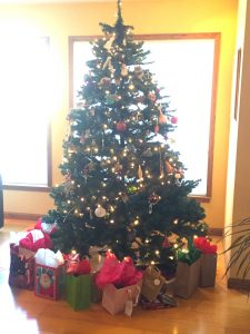 Image of a Christmas tree w/ presents