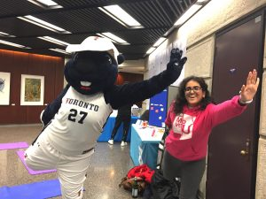 True Blue mascot and Move U volunteer posing