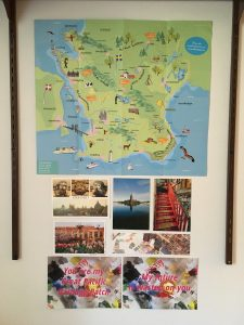 my wall of a map of Skane in Sweden, and some postcards
