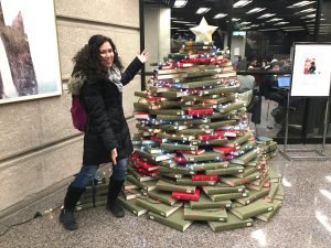 Author standing in front of book Christmas tree at Robarts