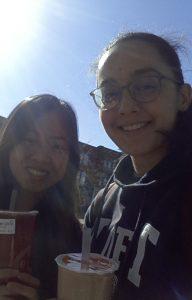 bubble tea held by two girls