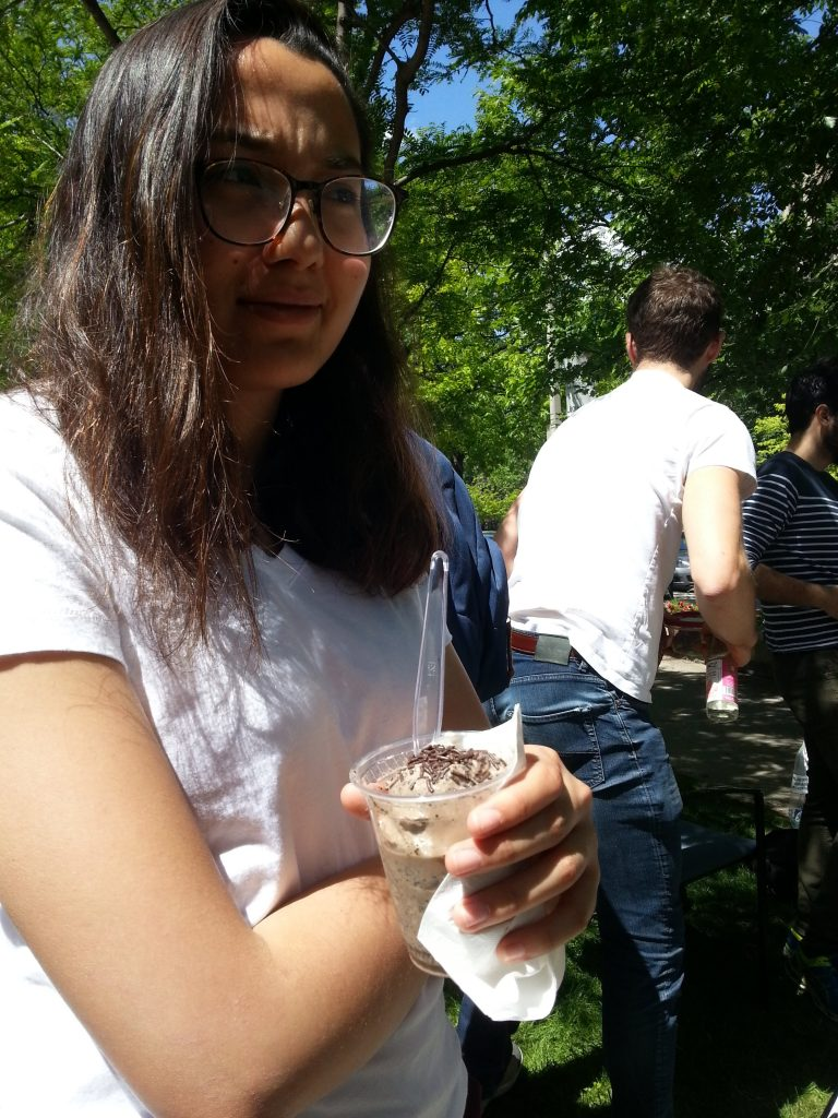 girl holding ice cream and looking dissapointed