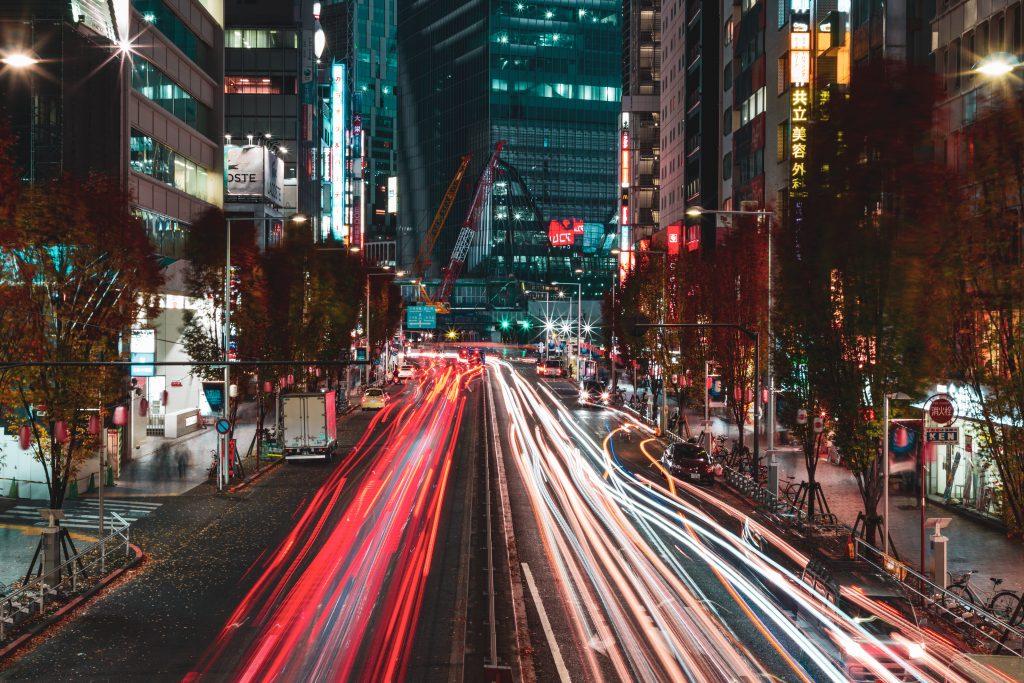 Cars headed down a busy highway in Shibuya.