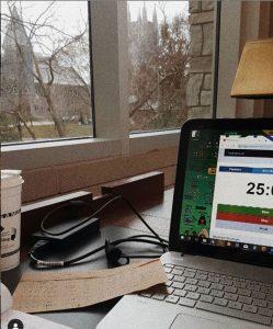 laptop and work set up facing window