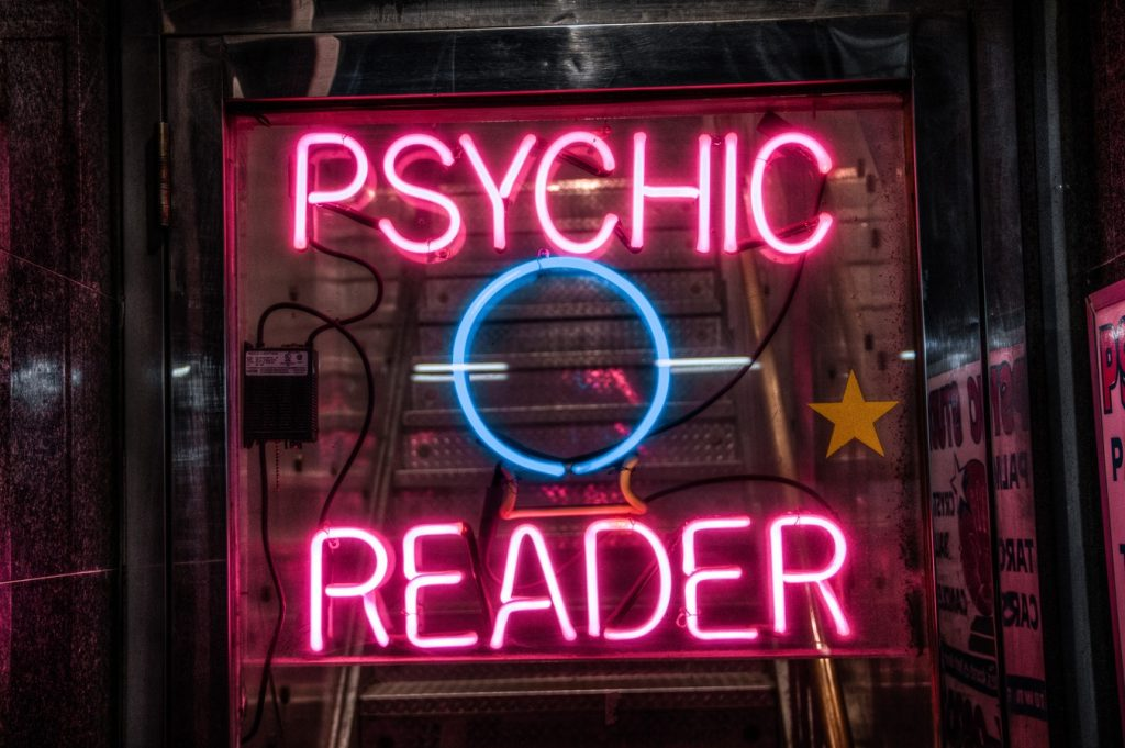 A photo of signage at the psychic's office. Caption: Deciding on a POSt would be easier if we were psychic