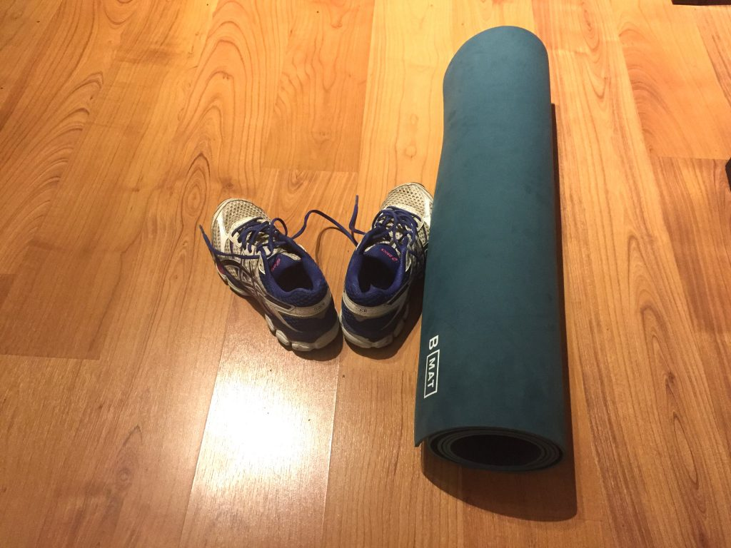 Image of running shoes and yoga mat