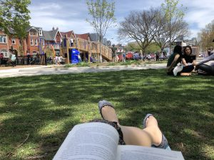 POV image of Francesca reading a book at a park