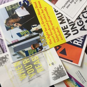 A pile of flyers from activist movements and rallies.