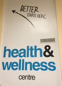 "A sign that says ""health & wellness centre: better starts here."""