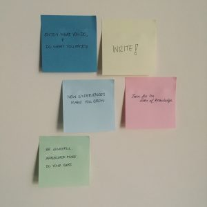 Sticky notes on the wall with mindful phrases.
