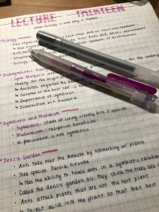 Handwritten notes and some pens