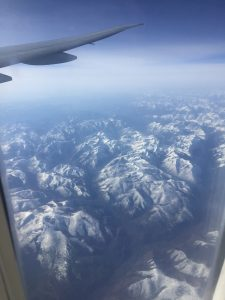 A picture of mountains from a plane window.