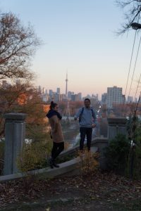My friend and I atop the Casa Loma staircase with the CN tower peering in the background