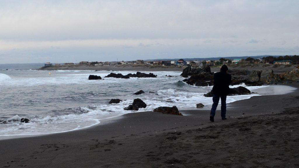 Man walking alone the sea shore
