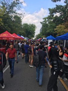 U of T students fill up St. George street with booth tents lining both sides of the street
