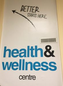 "A sign outside Health and Wellness at U of T, stating ""Better Starts Here."""